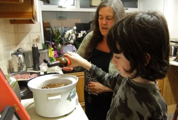 Carol and Joe cooking, 26/7/12